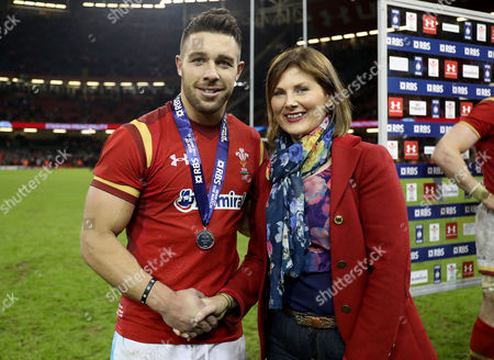 Stock Picture of Wales vs Ireland. Wales' Rhys Webb is presented with the Man of the Match award by Christina Woods