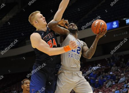 Stock Image of MT Blue Raiders forward JaCorey Williams (22)gets fouled as het goes up for a shot by UTEP Miners center Kelvin Jones (54) during the CUSA Tournament between the UTEP Miners and MT Blue Raiders at Legacy Arena in Birmingham AL Steve Roberts/Cal Sport Media