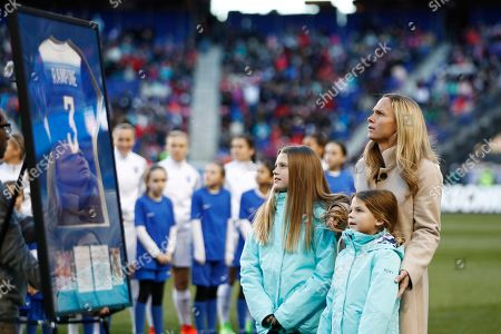 Former United States women's soccer player Christie Rampone, right, reacts during a ceremony honoring her prior to a SheBelieves Cup women's soccer match between the United States and England, in Harrison, N.J