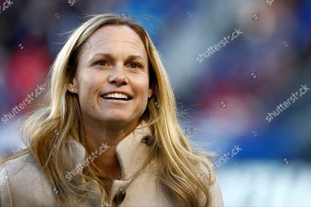 Stock Image of Former United States women's soccer player Christie Rampone looks on during a ceremony honoring her prior to a SheBelieves Cup women's soccer match between the United States and England, in Harrison, N.J