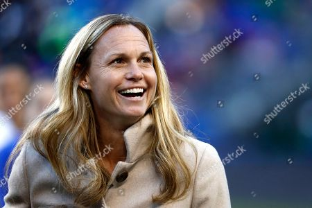 Former United States women's soccer player Christie Rampone looks on during a ceremony honoring her prior to a SheBelieves Cup women's soccer match between the United States and England, in Harrison, N.J