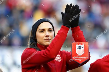 United States forward Alex Morgan reacts during a ceremony honoring former United States women's soccer player Christie Rampone prior to a SheBelieves Cup women's soccer match between the United States and England, in Harrison, N.J