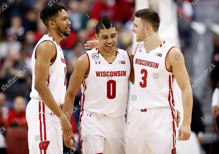 Jordan Hill, D'Mitrik Trice, Zak Showalter Wisconsin guards Jordan Hill, left, D'Mitrik Trice, and Zak Showalter (3) celebrate after the team's NCAA college basketball game against Indiana in the Big Ten tournament, in Washington. Wisconsin won 70-60
