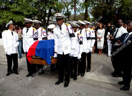Honor guards carry the coffin of the late former President of Haiti Rene Preval, in Port au Prince, Haiti, 10 March 2017. Hundreds of Haitians and international officials gathered at the National Museum of Haiti to pay respects to the late former president Rene Preval, who died at the age of 74 on 03 March 2017. The funeral service will be held on 11 March.