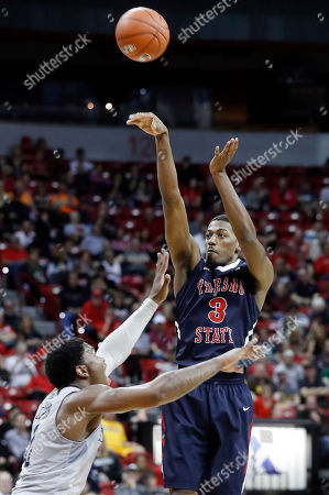 Cameron Oliver, Paul Watson Fresno State's Paul Watson shoots as Nevada's Cameron Oliver defends during the second half of an NCAA college basketball game in the Mountain West Conference tournament semifinals, in Las Vegas. Nevada defeated Fresno State 83-72