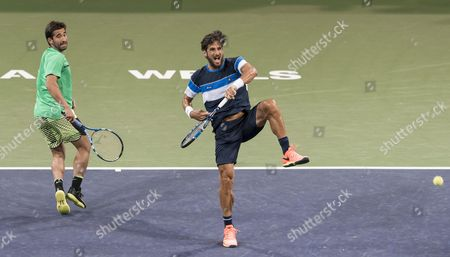 Mark Lopez of Spain and Feliciano Lopez of Spain in action on Day 5 at the BNP Paribas Open at Indian Wells Tennis Garden, Indian Wells, California, USA