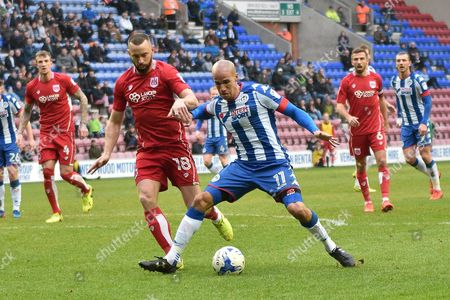 Wigan Athletic Midfielder, Gabriel Obertan (11) and Bristol City Forward,  Aaron Wilbraham (18)  during the EFL Sky Bet Championship match between Wigan Athletic and Bristol City at the DW Stadium, Wigan