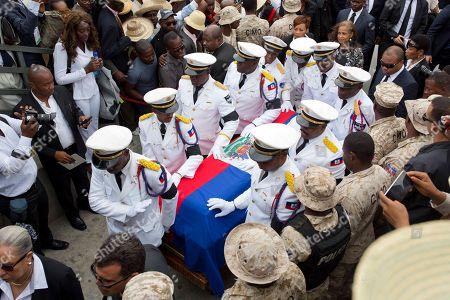 Police officers escort the coffin containing the remains of former President Rene Preval during funeral services in Port-au-Prince, Haiti, . Thousands of people from around Haiti gathered at a city park Saturday for Preval's state funeral capping six days of mourning for the man who led the country during a devastating January 2010 earthquake and its chaotic aftermath