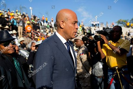 Former President Michel Martelly arrives for the funeral of former President Rene Preval in Port-au-Prince, Haiti, . Martelly along with two other former Haitian presidents ? Jocelerme Privert and Boniface Alexandre ? attended the funeral at the Champ de Mars plaza in downtown Port-au-Prince, where Preval's flag-draped casket was displayed