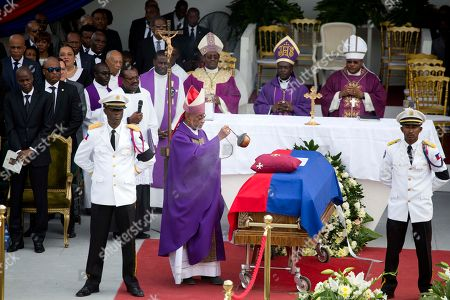 Bishop Joseph Lafontant incenses the coffin containing the remains of former President Rene Preval during his funeral service in Port-au-Prince, Haiti, . Thousands of people from around Haiti gathered at a city park Saturday for Preval's state funeral capping six days of mourning for the man who led the country during a devastating January 2010 earthquake and its chaotic aftermath