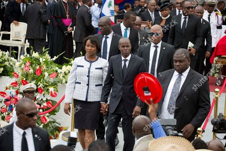 Jovenel Moise, Martine Haiti's President Jovenel Moise and his wife Martine holds hands as they leave the funeral service for former President Rene Preval in Port-au-Prince, Haiti, . Thousands of people from around Haiti gathered at a city park Saturday for Preval's state funeral capping six days of mourning for the man who led the country during a devastating January 2010 earthquake and its chaotic aftermath
