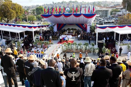 Haitians attend the funeral of former President Rene Preval at the Champs de Mars plaza in downtown Port-au-Prince, Haiti, . Thousands of people from around Haiti gathered at the city park Saturday for Preval's state funeral capping six days of mourning for the man who led the country during a devastating January 2010 earthquake and its chaotic aftermath
