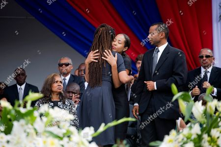 Patricia Preval, Dominique Preval, Alex Georges The daughters of former President Rene Preval, Dominique, left center, and Patricia, embrace during their late father's funeral service in Port-au-Prince, Haiti, . Thousands of people from around Haiti gathered at a city park Saturday for Preval's state funeral capping six days of mourning for the man who led the country during a devastating January 2010 earthquake and its chaotic aftermath. Pictured right is Alex Georges, Dominique