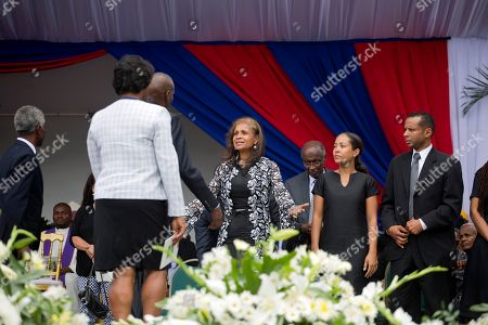 Elisabeth Debrosse Preval, Jovenel Moise The wife of former President Rene Preval, Elisabeth Debrosse Preval, left center, puts out her arms to embrace Haiti's President Jovenel Moise during the late leader's funeral service in Port-au-Prince, Haiti, . Thousands of people from around Haiti gathered at a city park Saturday for Preval's state funeral capping six days of mourning for the man who led the country during a devastating January 2010 earthquake and its chaotic aftermath. Pictured right center is the late leader's daughter Dominique, and her husband Alex Georges