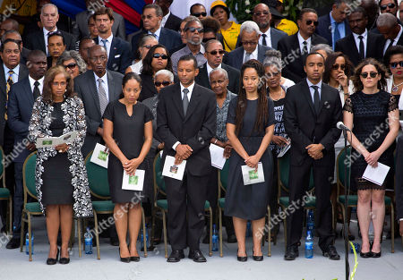 Elisabeth Debrosse Preval, Patricia Preval, Dominique Preval The wife of Haiti's former President Rene Preval, Elisabeth Debrosse Preval, front row, from left center to right; Dominique Preval Georges; Alex Georges; Patricia Preval; Karl Delatour and Kosta Delatour, stand during the late leader's funeral service in Port-au-Prince, Haiti, . Thousands of people from around Haiti gathered at a city park Saturday for Preval's state funeral capping six days of mourning for the man who led the country during a devastating January 2010 earthquake and its chaotic aftermath
