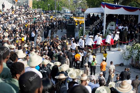 Police officers arrive with the coffin containing the remains of former President Rene Preval, at Champ de Mars plaza, in Port-au-Prince, Haiti, . Thousands of people from around Haiti gathered at the city park Saturday for Preval's state funeral capping six days of mourning for the man who led the country during a devastating January 2010 earthquake and its chaotic aftermath