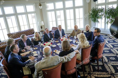 United States President Donald Trump has a working lunch with staff and cabinet members and significant others at his golf course, Trump National Golf Club in Potomac Falls, Virginia, U.S.,. Seated around the table from left: Assistant to the President and White House Chief Strategist Steve Bannon ; White House Chief of Staff Reince Priebus ; White House Press Secretary Sean Spicer ; Merle Bari Shulkin; US Secretary of Veterans Affairs David Shulkin ; President Trump; US Secretary of Commerce Wilbur Ross; Hilary Geary Ross; US Secretary of the Treasury Steven Mnuchin ; Louise Linton ; Karen Hernest Kelly; and US Secretary of Homeland Security John F. Kelly.