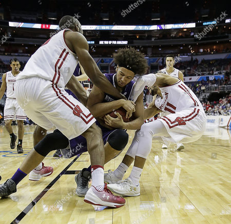 Wisconsin Badgers G #11 Jordan Hill tries to rip the ball out during a Big 10 Men's Basketball Tournament game between the Wisconsin Badgers and the Northwestern Wildcats at the Verizon Center in Washington D.C.. Wisconsin defeats Northwestern, 76-48