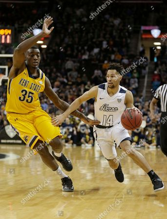 Jimmy Hall, Noah Robotham Akron's Noah Robotham, right, drives past Kent State's Jimmy Hall during the first half of an NCAA college basketball championship game of the Mid-American Conference tournament, in Cleveland