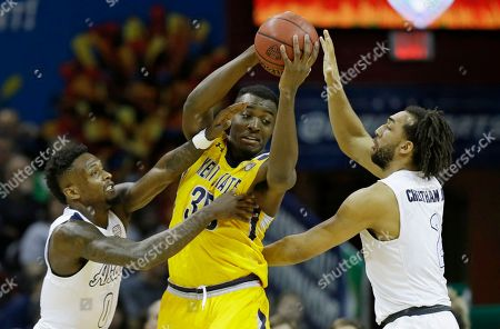Kwan Cheatham, Jimmy Hall, Jimond Ivey Kent State's Jimmy Hall, center, looks to pass against Akron's Jimond Ivey, left, and Kwan Cheatham during the first half of an NCAA college basketball championship game of the Mid-American Conference tournament, in Cleveland