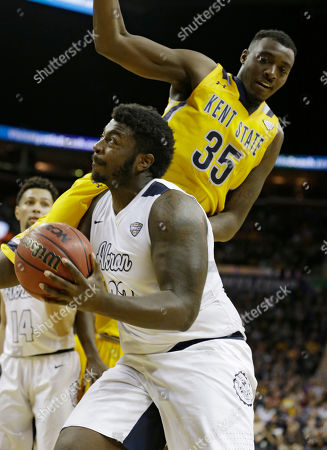 Jimmy Hall, Isaiah Johnson Akron's Isaiah Johnson, left, is fouled by Kent State's Jimmy Hall during the second half of an NCAA college basketball championship game of the Mid-American Conference tournament, in Cleveland. Kent State won 70-65