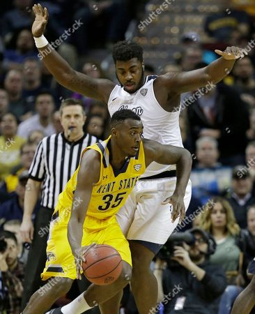 Jimmy Hall, Isaiah Johnson Kent State's Jimmy Hall, front, drives past Akron's Isaiah Johnson during the second half of an NCAA college basketball championship game of the Mid-American Conference tournament, in Cleveland. Kent State won 70-65