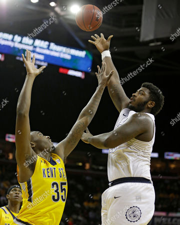 Isaiah Johnson, Jimmy Hall Akron's Isaiah Johnson, right, shoots against Kent State's Jimmy Hall during the second half of an NCAA college basketball championship game of the Mid-American Conference tournament, in Cleveland. Kent State won 70-65