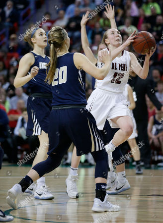 Stock Photo of Lizzie Miller, Sydney Levy De Pere's Lizzie Miller (12) gets past Appleton North's Sydney Levy (20) in the Division 2 finals in the WIAA girls' state basketball championships in Green Bay, Wis