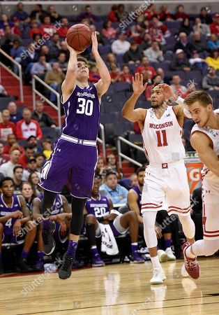 Bryant McIntosh, Jordan Hill Northwestern guard Bryant McIntosh (30) shoots against Wisconsin guard Jordan Hill (11) during the second half of an NCAA college basketball game in the Big Ten tournament, in Washington. Wisconsin won 76-48