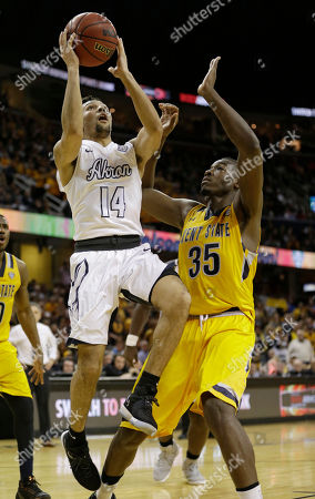 Jimmy Hall, Noah Robotham Akron's Noah Robotham (14) shoots against Kent State's Jimmy Hall during the second half of an NCAA college basketball championship game of the Mid-American Conference tournament, in Cleveland
