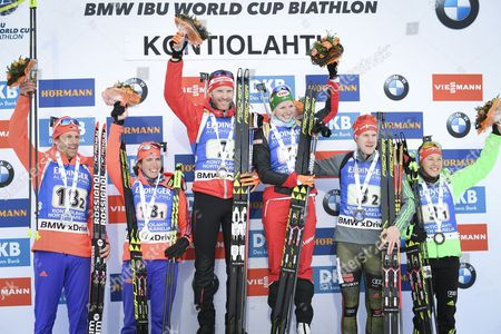 (L-R) Team USA, the second place; Lowell Bailey and Susan Dunklee, winner team Austria with Simon Eder and Lisa Theresa Hauser and third placed team Germany with Roman Rees and Laura Dahlmeier pose after the Single Mixed Relay Competition at the Kontiolahti Biathlon Stadium in Finland, 12 March 2017.