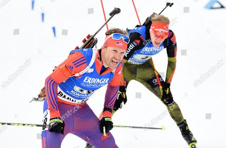 Lowell Bailey (L)  of USA  and Roman Rees of Germany in action during the Single Mixed Relay Competition at the Kontiolahti Biathlon Stadium in Finland, 12 March 2017.