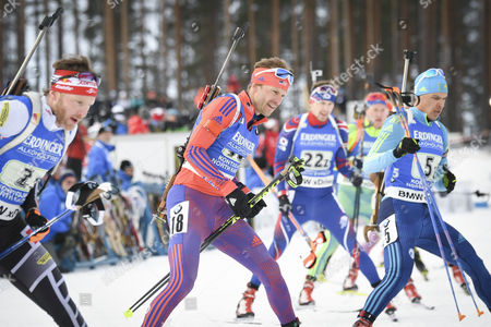Simon Eder of Austria (L), Lowell Bailey of USA (C) and Yan Savitskiy of Kazakhstan (R) in action during the Single Mixed Relay Competition at the Kontiolahti Biathlon Stadium in Finland, 12 March 2017.