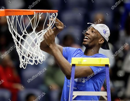 Kentucky forward Edrice Adebayo cuts down the net after Kentucky beat Arkansas in an NCAA college basketball game for the championship of the Southeastern Conference tournament, in Nashville, Tenn. Kentucky won 82-65