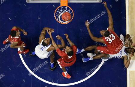 Daryl Macon, Edrice Adebayo, Arlando Cook, Moses Kingsley, Dominique Hawkins Kentucky and Arkansas players watch as a shot falls in during the first half of an NCAA college basketball game for the championship of the Southeastern Conference tournament, in Nashville, Tenn. Kentucky won 82-65. From left are Arkansas guard Daryl Macon, Kentucky forward Edrice Adebayo (3), Arkansas forward Arlando Cook (5), Arkansas forward Moses Kingsley (33) and Kentucky guard Dominique Hawkins