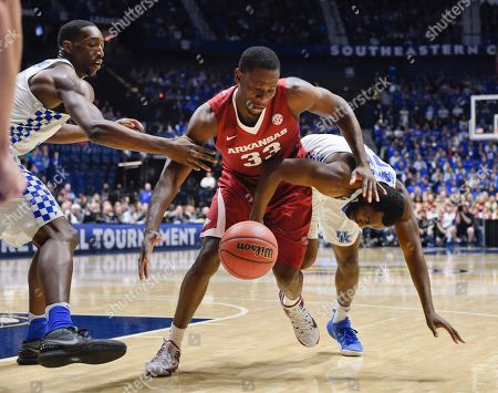Moses Kingsley, Edrice Adebayo, Dominique Hawkins Arkansas forward Moses Kingsley (33) battles Kentucky's Edrice Adebayo, left, and Dominique Hawkins, right, for the ball in the first half of an NCAA college basketball game for the championship of the Southeastern Conference tournament, in Nashville, Tenn