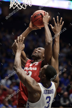 Moses Kingsley, Edrice Adebayo Arkansas forward Moses Kingsley (33) shoots over Kentucky forward Edrice Adebayo (3) in the second half of an NCAA college basketball game for the championship of the Southeastern Conference tournament, in Nashville, Tenn