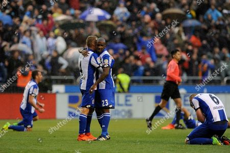 Deportivo's Alex Bergantinos, Gael Kakuta and Raul Albentosa, from second left to right, celebrate after their 2-1 victory over Barcelona after a Spanish La Liga soccer match between Deportivo and Barcelona at the Riazor stadium in A Coruna, Spain