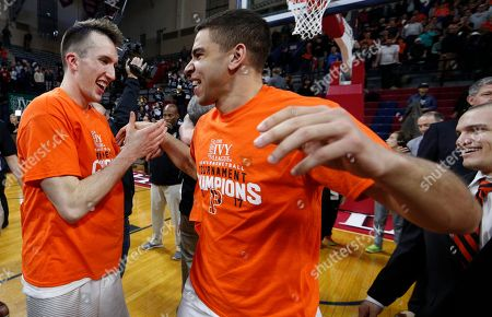 Steven Cook, Alexander Lee Princeton's Steven Cook, left, celebrates the win with Alexander Lee, right, following an NCAA college basketball championship game in the Ivy League Tournament, in Philadelphia. Princeton won 71-59