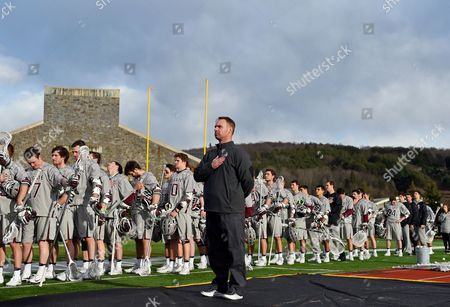 Colgate Raiders head coach Mike Murphy looks on during the National Anthem prior to the game against the Hobart Statesmen on Wednesday, March, 8, at Andy Kerr Stadium in Hamilton, New York. Colgate defeated Hobart 13-6