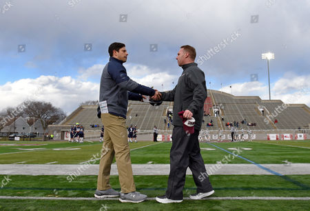 Hobart Statesmen head coach Greg Raymond and Colgate Raiders head coach Mike Murphy shake hands prior to the game on Wednesday, March, 8, at Andy Kerr Stadium in Hamilton, New York. Colgate defeated Hobart 13-6