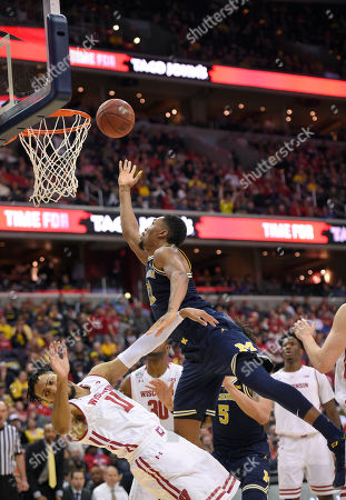 Zak Irvin, Jordan Hill Michigan guard Zak Irvin, top, goes to the basket against Wisconsin guard Jordan Hill (11) during the second half of an NCAA college basketball game for the Big Ten tournament title, in Washington. Hill was charged with a foul on the play. Michigan won 71-56