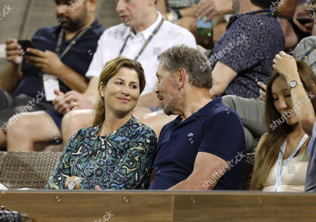 Mirka Federer and Larry Ellison in attendance during the match between Roger Federer of Switzerland Stephane Robert of France during the BNP Paribas Open at Indian Wells Tennis Garden in Indian Wells, California