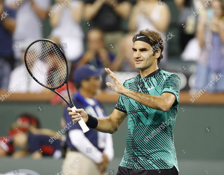 Roger Federer of Switzerland celebrates his victory against Stephane Robert of France during the BNP Paribas Open at Indian Wells Tennis Garden in Indian Wells, California