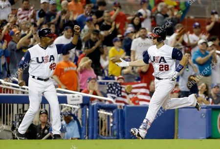 Buster Posey, Willie Randolph United States' Buster Posey (28) rounds third base after hitting a solo home run as third base coach Willie Randolph prepares to congratulate Posey in the seventh inning in a first-round game of the World Baseball Classic against Canada, in Miami. The United States won 8-0