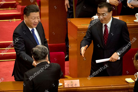 Li Keqiang, Xi Jinping Chinese President Xi Jinping, left, and Premier Li Keqiang, right, shake hands with Yu Zhengsheng, chairman of the Chinese People's Political Consultative Conference (CPPCC) after the closing session of the CPPCC at Beijing's Great Hall of the People on