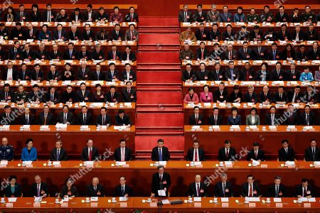 Yu Zhengsheng, Chairman of the Chinese People's Political Consultative Conference (CPPCC), foreground center, delivers a closing speech for the Chinese People's Political Consultative Conference (CPPCC) at the Great Hall of the People in Beijing