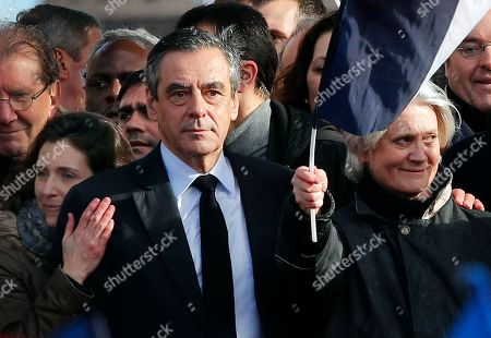 """French conservative presidential candidate Francois Fillon, his wife Penelope, right, and his daughter Marie appear during a rally in Paris, . Fillon is urging his supporters not to """"give up the fight"""" for the presidency despite corruption allegations dogging him"""
