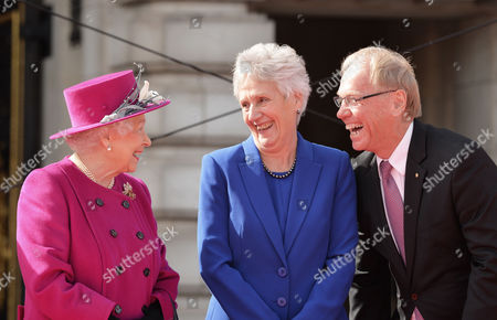 Stock Picture of Queen Elizabeth II, Louise Martin, President of the Commonwealth Games Federation and Peter Beattie, Gold Coast Commonwealth Games Organizing Committee at the launch of The Queen's Baton Relay