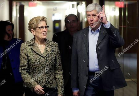 Rick Snyder, Kathleen Wynne Michigan Gov. Rick Snyder and Ontario Premier Kathleen Wynne walk to their joint news conference, in Detroit